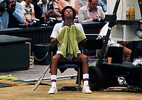 Tennis - 1975  Wimbledon Championships - Ashe v Connors. 02/07/1975<br /><br />Arthur Ashe (USA) sits and meditates in between games on Centre Court<br /><br />Credit: Colorsport