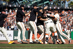 Oct 3, 2021; San Francisco, California, USA; San Francisco Giants players celebrate their 11-4 victory over the San Diego Padres at Oracle Park. The Giants clinched the National League West Division title with the win. Mandatory Credit: D. Ross Cameron-USA TODAY Sports