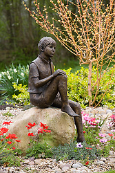 'Boy on a Rock' by Jane Hogben with Anemone pavonina and the stems of Cornus sanguinea 'Midwinter Fire'