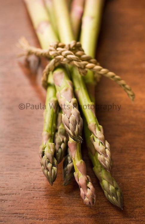 Bundle of Asparagus on wooden tabletop