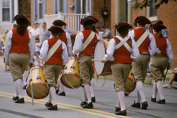 Americana fife and drum corp  march in small town holiday celebration parade. Stock photo