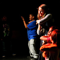 010813  Adron Gardner/Independent<br /> <br /> Melissa Levenstein leads a group of youngsters in the Macarena during a family dance party night hosted by Vanessa Wilde at the El Morro theater in Gallup Wednesday.