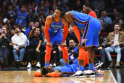 March 8, 2019 - Los Angeles, CA, U.S. - LOS ANGELES, CA - MARCH 08: Oklahoma City Thunder Guard Russell Westbrook (0) and Oklahoma City Thunder Forward Jerami Grant (9) look at Oklahoma City Thunder Guard Dennis Schroder (17) on the ground during a NBA game between the Oklahoma City Thunder and the Los Angeles Clippers on March 8, 2019 at STAPLES Center in Los Angeles, CA. (Photo by Brian Rothmuller/Icon Sportswire) (Credit Image: © Brian Rothmuller/Icon SMI via ZUMA Press)
