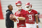 Arkansas quarterbacks Tyler Wilson (8) and Jacoby Walker (9) practice throwing the ball during Spring Practice on Tuesday, March 15, 2011, in Fayetteville, Ark. (Photo by Beth Hall)