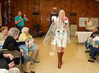 """The Friendship Club's Fashion Show with humor has Ella Brown taking the runway in her """"bridle"""" attire accented with flowers and a """"reining"""" train along with her 10 carot wedding ring, Yum!  Where's her horse and coach?  (Karen Bobotas/for the Laconia Daily Sun)"""