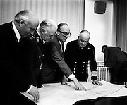 Paddy Donegan, TD, Minister for Defence (centre, wearing glasses) indicating on the map where five tonnes of arms and ammunition from LIbya, bound for the IRA, had been found on the ship Claudia, when it was intercepted near Helvick Head, Co Waterford. Also in the picture are members of the Naval Service and Army. <br /> <br /> 29/03/1973