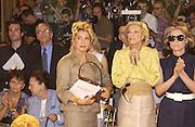 Catherine Deneuve and Nan Kempner. Yves St. Laurent couture show. Intercontinental. Paris. 11 July 2001. © Copyright Photograph by Dafydd Jones 66 Stockwell Park Rd. London SW9 0DA Tel 020 7733 0108 www.dafjones.com