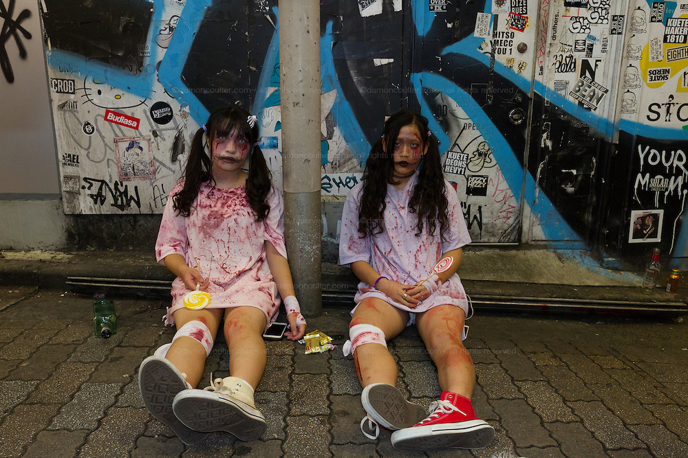 Two Japanese women, dressed as macabre elementary school students during the Halloween celebrations in Shibuya, Tokyo, Japan. Saturday October 29th 2016 Halloween celebration in Japan have grown massively in the last few years. To ensure the safety of the crowds in Shibuya this year, the police closed several roads leading to the famous Hachiko Square, allowing costumed revellers to spread over a larger area.