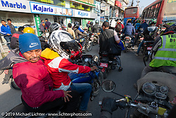 Mixing in with local traffic on our return to Kathmandu on Motorcycle Sherpa's Ride to the Heavens motorcycle adventure in the Himalayas of Nepal. Riding from Daman back to Kathmandu. Wednesday, November 13, 2019. Photography ©2019 Michael Lichter.
