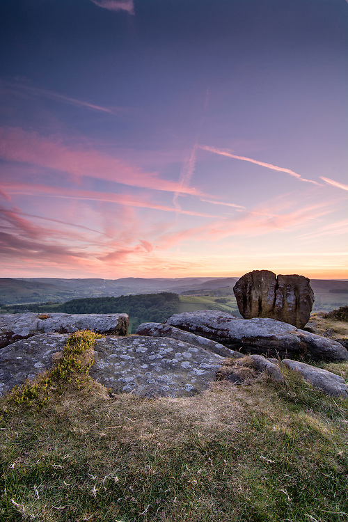 The afterglow from the sunset at Carhead Rocks, Peak District, UK.
