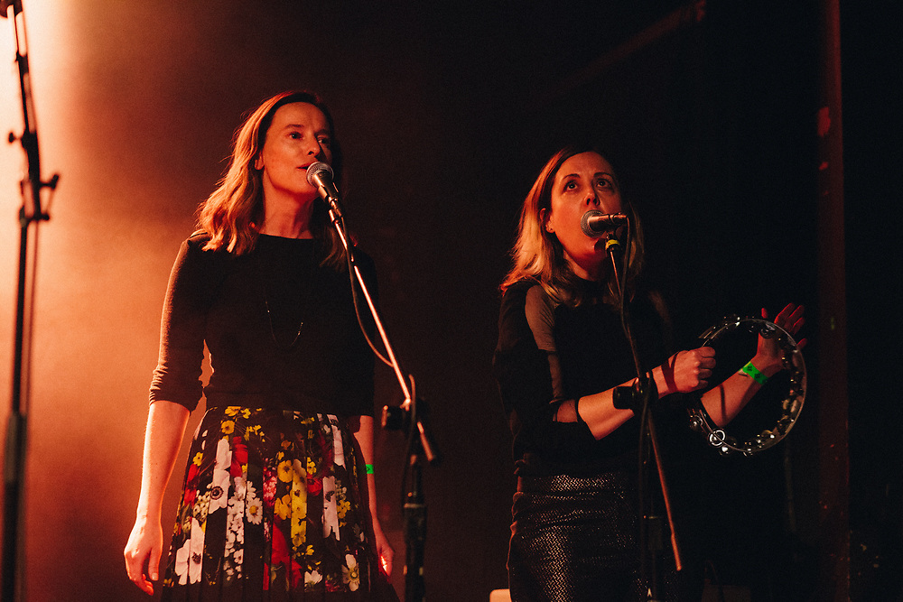 Chloe Johnson and Corin Tucker performing at Help The Hoople, a benefit for Scott McCaughey, at the Wonder Ballroom in Portland, OR - Jan 6, 2018. Photo by Jason Quigley.