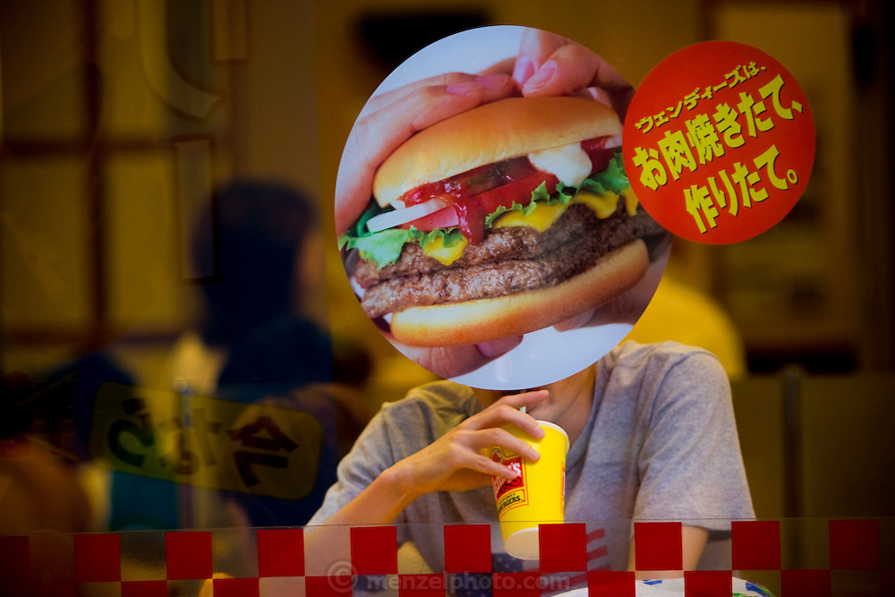 A patron finishes his meal at a Shibuya-area Wendy's fast-food restaurant in Tokyo, Japan. The Wendy's hamburger chain closed all of their 71 restaurants in Japan at the end of 2009. (From the book What I Eat: Around the World in 80 Diets.)