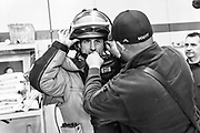 Washington Capital forward Garnet Hathaway tries on a bomb suit during his visit to a local fire station for his social initiative Haths Heroes on February 19, 2020.