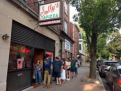 Sally's Apizza Restaurant front of building with people in Line - New Haven CT 02 June 2019