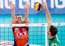 Andrej Flajs of ACH vs Tsvetan Sokolov of Cuneo during volleyball match between ACH Volley Ljubljana and Bre Banca Lannutti Cuneo (ITA) in Playoff 12 game of CEV Champions League 2012/13 on January 15, 2013 in Arena Stozice, Ljubljana, Slovenia. (Photo By Vid Ponikvar / Sportida.com)
