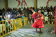 Female wrestler Alicia Flores making her entrance and signalling to crowd. Lucha Libre wrestling origniated in Mexico, but is popular in other latin Amercian countries, including in La Paz / El Alto, Bolivia. Male and female fighters participate in the theatrical staged fights to an adoring crowd of locals and foreigners alike.