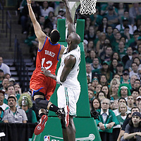 14 May 2012: Philadelphia Sixers shooting guard Evan Turner (12) goes to the basket over Boston Celtics power forward Kevin Garnett (5) during the Philadelphia Sixers 82-81 victory over the Boston Celtics, in Game 2 of the Eastern Conference semifinals playoff series, at the TD Banknorth Garden, Boston, Massachusetts, USA.