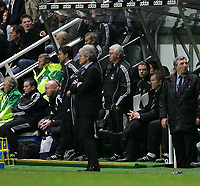Photo: Andrew Unwin.<br />Newcastle United v Blackburn Rovers. The Barclays Premiership. 21/01/2006.<br />Newcastle's manager, Graeme Souness (R), sits nervously as Blackburn's manager, Mark Hughes (C), looks on.