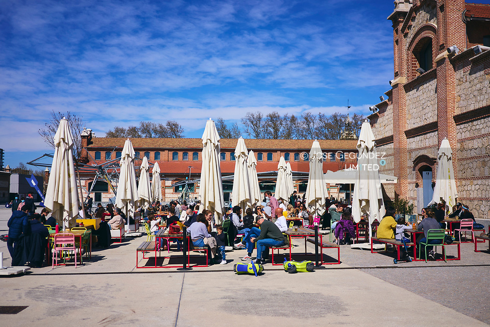 People sit at a bar's terrace and enjoy spring time in Madrid on March 21, 2021<br /> Young people from Europe Countries, mostly from France and Italy are pouring into the heart of Madrid, packing the terraces of cafes, wandering through fashionable streets and booking Airbnbs