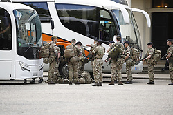 © Licensed to London News Pictures. 24/05/2017. London, UK. Soldiers are seen lining up to get on buses at Wellington barracks. It is though that they are being deployed around the capital. The terrorism threat level has been raised to critical and Operation Temperer has been deployed. 5,000 troops are taking over patrol duties under police command. Photo credit: Peter Macdiarmid/LNP