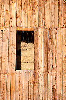 Detail shot of barn and hay.