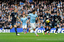 Manchester City's Sergio Aguero attempts to chip the ball over the keeper - Photo mandatory by-line: Dougie Allward/JMP - Tel: Mobile: 07966 386802 24/11/2013 - SPORT - Football - Manchester - Etihad Stadium - Manchester City v Tottenham Hotspur - Barclays Premier League