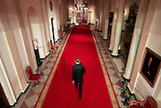 U.S. President Barack Obama walks through the Cross Hall after a news conference at the White House in Washington, July 22, 2009.   REUTERS/Jim Young