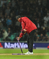 Cricket - 2017 West Indies Tour of England - Fourth One Day International (ODI): England vs. West Indies<br /> <br /> All over - The Umpire pulls up the stumps as the rain comes down and England win under the 'Duckworth  Lewis ' rule by 6 runs at The Oval.<br /> <br /> COLORSPORT/ANDREW COWIE