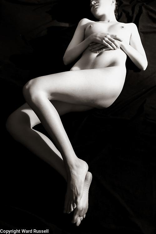 Nude reclining.