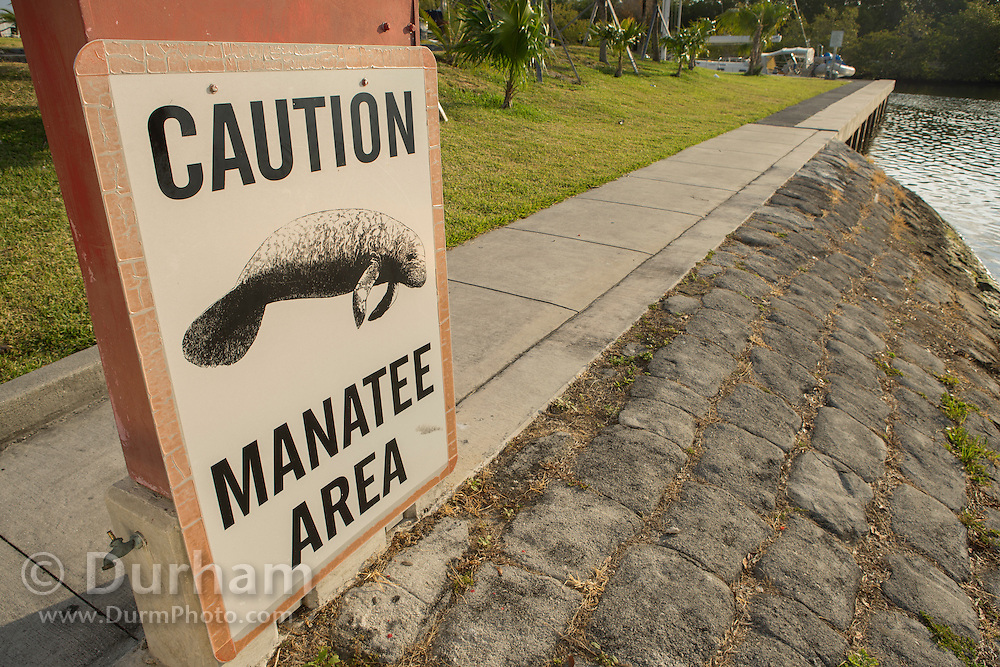 A sign warns boaters to be cautious of manateees at Black Point Marina, Florida.