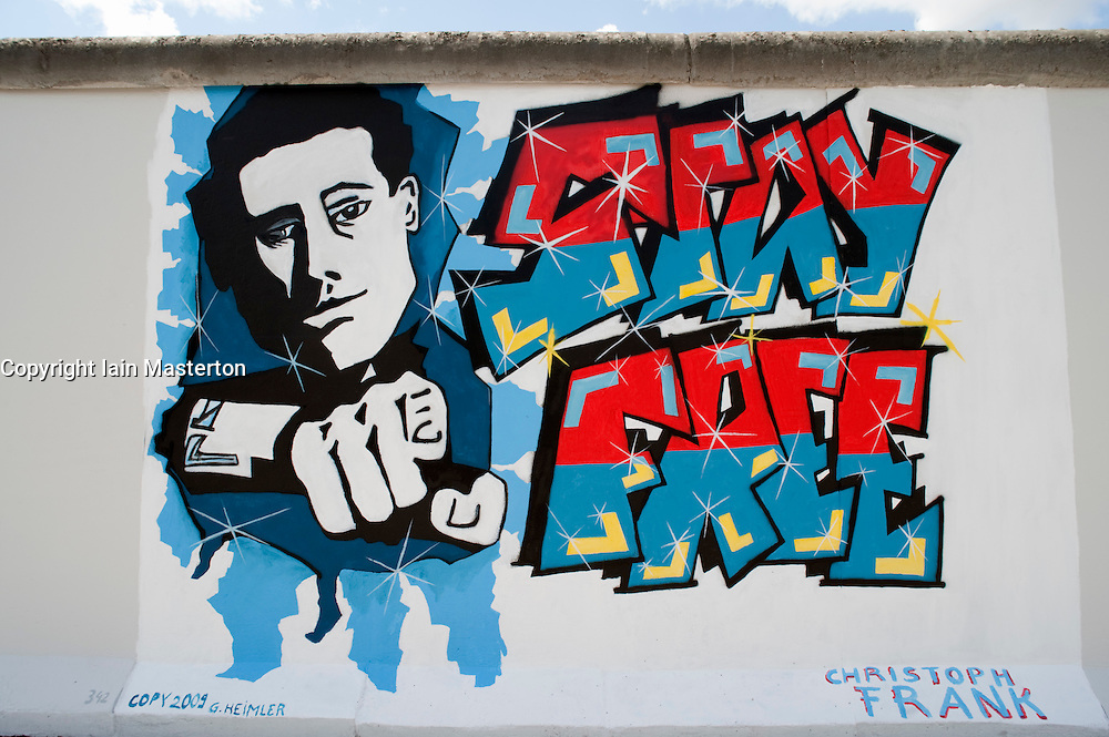 "Detail of newly repainted mural ""Stay Free"" on Berlin Wall at East Side Gallery in Berlin 2009"
