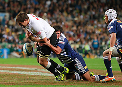 Stormers flank Nick Koster (c) tackles Sharks flank Willem Alberts (L)  during their Super Rugby match in Cape Town, South Africa 30 April 2011
