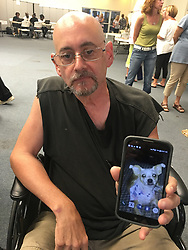 October 8, 2018 - USA - Alex Carias, 60, shows a picture of his terrier, Gus, who joined him and rode out Hurricane Florence inside their pickup truck in Carteret County. The two have stayed at a Red Cross shelter in Morehead City. (Credit Image: © Josh Shaffer/Raleigh News & Observer/TNS via ZUMA Wire)
