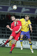 Sam Vokes of Wales is challenged by Olof Mellberg of Sweden. International friendly, Wales v Sweden at the Liberty Stadium in Swansea on Wed 3rd March 2010. pic  by  Andrew Orchard