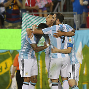 FOXBOROUGH, MASSACHUSETTS - JUNE 18:  Erik Lamela #18 of Argentina is congratulated after scoring by team mates Lionel Messi #10 Gonzalo Higuain #9 and Marcos Rojo #16 of Argentina during the Argentina Vs Venezuela Quarterfinal match of the Copa America Centenario USA 2016 Tournament at Gillette Stadium on June 18, 2016 in Foxborough, Massachusetts. (Photo by Tim Clayton/Corbis via Getty Images)