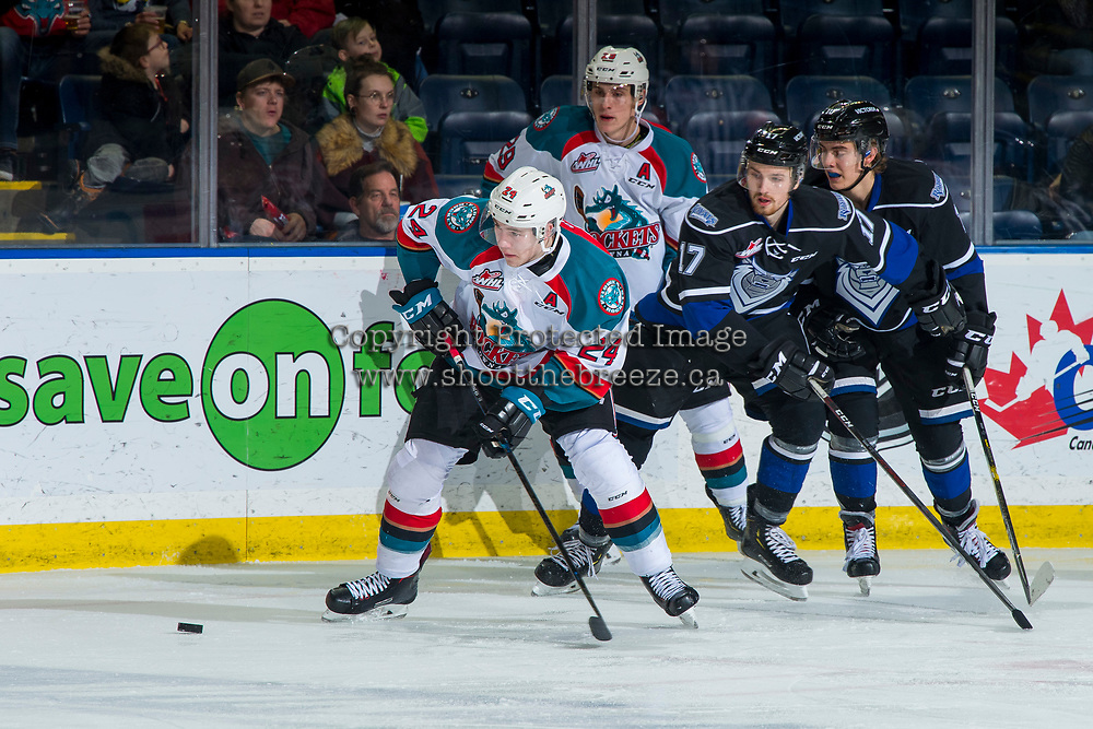 KELOWNA, CANADA - JANUARY 25: Kyle Topping #24 of the Kelowna Rockets passes the puck against the Victoria Royals  on January 25, 2019 at Prospera Place in Kelowna, British Columbia, Canada.  (Photo by Marissa Baecker/Shoot the Breeze)
