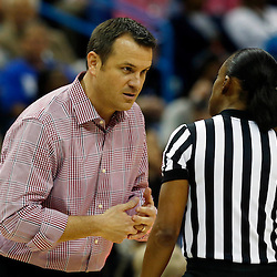 Apr 9, 2013; New Orleans, LA, USA; Louisville Cardinals head coach Jeff Walz (left) talks to an official against the Connecticut Huskies during the first half of the championship game in the 2013 NCAA womens Final Four at the New Orleans Arena. Mandatory Credit: Derick E. Hingle-USA TODAY Sports