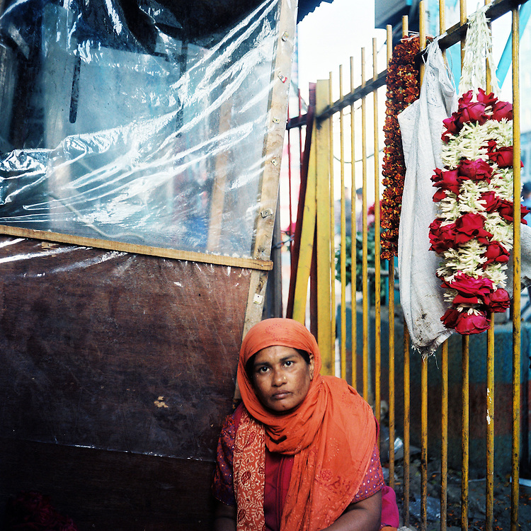 Flower market at Shabag, next to Dhaka University, often considered the heart of the independence movement in Bangladesh.  On the night of 25 March 1971, West Pakistani troops opened fire on unarmed civilians within and around the campus, killing thousands over the course of two days.<br /> <br /> Dhaka, Bangladesh.  February 2011.