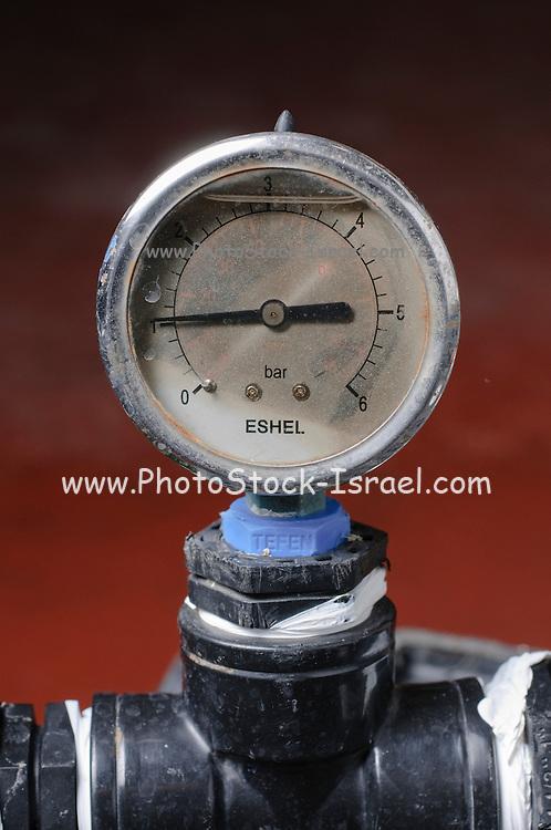 Water pressure gauge on a pipe