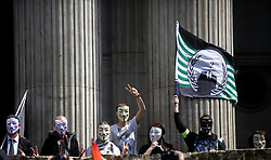 © Licensed to London News Pictures. 12/05/2012. London, Britain.  Occupy London protesters wearing masks posing in front of St. Paul's Cathedral. Photo credit : Thomas Campean/LNP