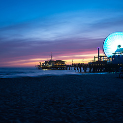 Santa Monica Pier sunset photography. Santa Monica Pier is along the Pacific Ocean in Southern California in the United States. Copyright ⓒ 2017 Paul Velgos with All Rights Reserved.