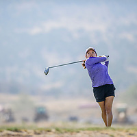 Kirtland Central Bronco Tiger Lily Tsosie tees off at the Grants Golf tournament  at the Coyote Del Malpais in Grants Tuesday.