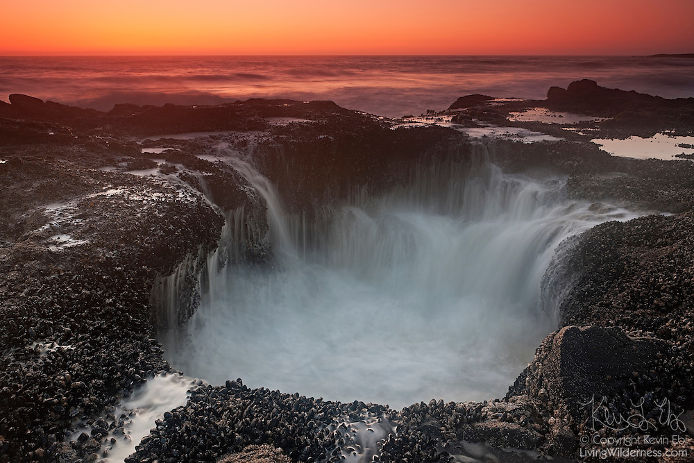 Pacific Ocean waves flow into the remnants of a blowhole at Cape Perpetua on the Oregon coast. Blowholes are essentially skylights in ocean caves. At high tide, water fills the cave and the pressure of the incoming waves forces water through the hole, high into the air. Over time, erosion has enlarged this hole so that water no longer jets out of it.
