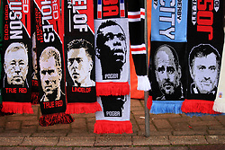 10 December 2017 -  Premier League - Manchester United v Manchester City - A row of scarves featuring Manchester United greats, past and present alongside a scarf bearing an image of Josep Guardiola manager of Manchester City - Photo: Marc Atkins/Offside