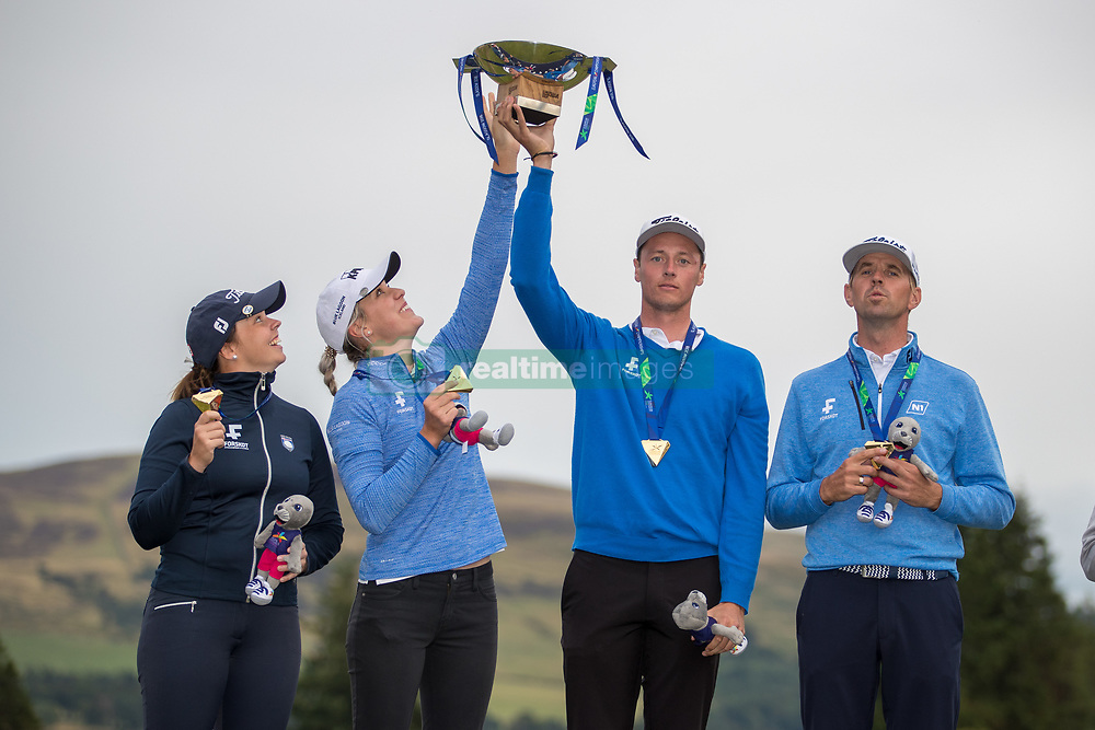 Winners Iceland hoist the trophy aloft after their victory, L to R Valdis Thora Jonsdottir, Olafia Kristinsdottir, Birgir Hafthorsson and Axel Boasson during day ten of the 2018 European Championships at Gleneagles PGA Centenary Course.