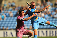 Ian Henderson and Jack Grimmer during the EFL Sky Bet League 1 match between Coventry City and Rochdale at the Ricoh Arena, Coventry, England on 1 September 2018.