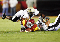 1 September 2007: Tailback #2 C.J. Gable in gets tackled by Shiloh Keo and Jo'Artis Ratti of Idaho during the USC Trojans college football team defeated the Idaho Vandals 38-10 at the Los Angeles Memorial Coliseum in CA.  NCAA Pac-10 #1 ranked team first game of the season.