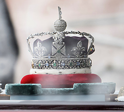 © Licensed to London News Pictures. 19/12/2019. London, UK. The Imperial State Crown is seen being driven down The Mall on her way to The Houses of Parliament for the State Opening of Parliament. Photo credit: Ben Cawthra/LNP