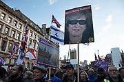 Theresa May as a robber in a mask at the Brexit Betrayal March - Brexit Means Exit! organised by the UK Independence Party, described as a 'cross-party peoples rally to show our MPs that the 17.4 million who voted to leave the EU really meant what we said' on Brexit on 9th December 2018 in London, United Kingdom. The demonstration opposes Theresa Mays Withdrawal Agreement' however is being seen by counter protesters as racist following the appointment by UKIP of the far-right campaigner Tommy Robinson.