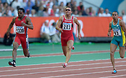 From left: Ato Boldon of Trinidad and Tobago, Nicolas Macrozonaris of Canada and Patrick Johnson of Austrail (43) in the second round of the 100 meters in the IAAF World Championships in Athletics at Stade de France on Sunday, Aug, 24, 2003.